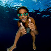 A small boy in Indonesia loves hanging out with underwater photographers